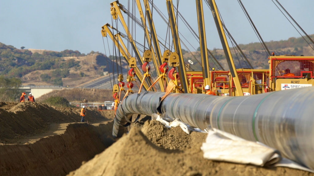 Welded steel pipes are lowered into trenches, Northern Greece, November 2016