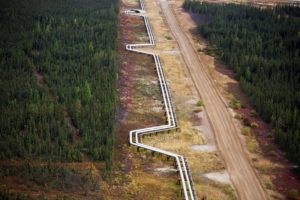 FILE PHOTO - Pipelines carrying steam and oil run at the Suncor Firebag in-situ oil sands operations near Fort McMurray.