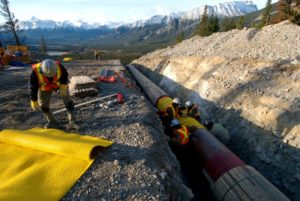 File Photo: Workers construct the Anchor Loop section of Kinder Morgan's Trans Canada Pipeline in Jasper National Park